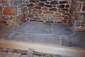 a newly restored custom stone fireplace hearth