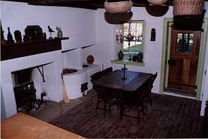 a fully restored historic kitchen area with fireplace