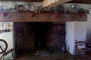 a brick fireplace in an old home