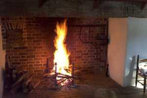 a fire in a brick fireplace