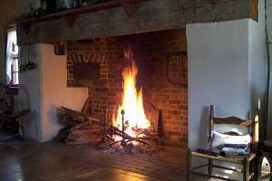 a roaring fire in a brick fireplace