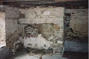 an old stone fireplace that is in bad shape - before