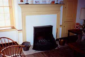 a fully restored fireplace, mantel and cabinet area - after