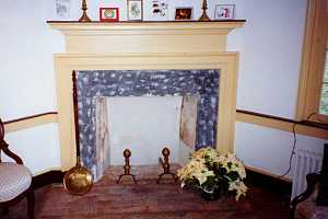 a restored fireplace with a flower on the brick base - after