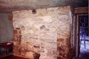 a historic building interior where a fireplace was previously filled in - before