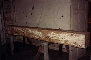 a wooden beam on two saw horses