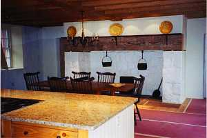 decorated kitchen and fireplace area of a historic home