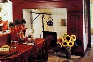 large fireplace with red mantel and kitch furniture