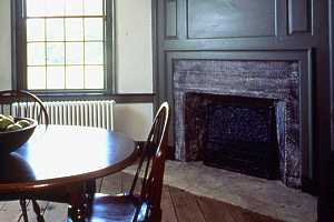 a restored kitchen and fireplace in a historic home - after