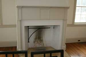 a fireplace with tan mantel