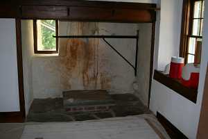 a cracked and peeling fireplace