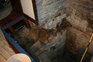 digging out the stone in a fireplace chimney