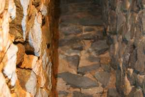 looking up a stone fireplace chimney