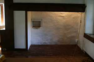 a repaired fireplace area with brick base