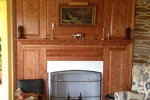 fully restored fireplace area with wooden mantle - after