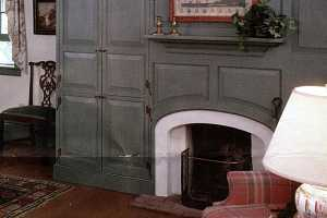 gray cabinetry around a fireplace