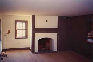 an empty brick fireplace