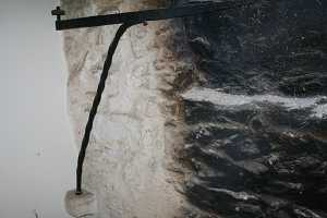 back wall of a fireplace with black soot built up