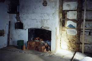 an old fireplace with dozens of red bricks stacked in front of it and in buckets