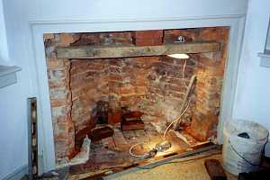 a crumbling brick fireplace - before