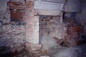an old fireplace and home with crumbling stone and bricks
