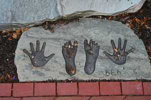 an engraved stone with feet and hand prints that reads Ben - 5