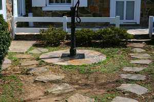 custom stone well cap surrounding pump