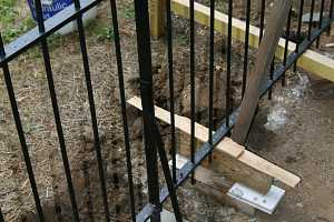 a black iron fence installation