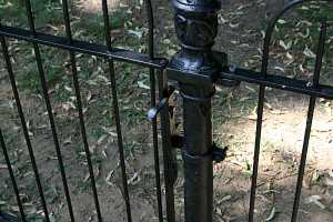 a black iron fence gate