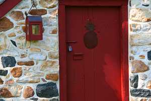 A restored 1794 spring house with red door