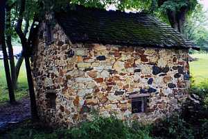 A restored stone spring house