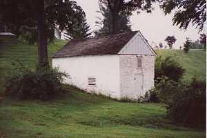 A white stone spring house