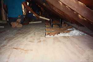 2 men doing steelwork in an attic