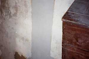 a concrete wall with new concrete clearly drying