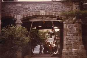 Stone archway being prepped with wooden scaffolding for repair