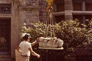 A decorative stone piece of an archway being transported for repair