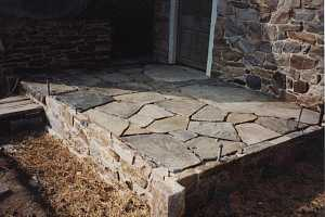 Re-assembled stone patio nearing completion