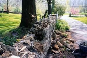 a stone wall that is falling apart