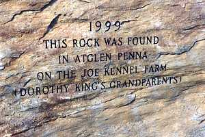 a stone that is engraved with the words: 1999 this rock was found in atglen penna on the joe kennel farm (dorothy king's grandparents)