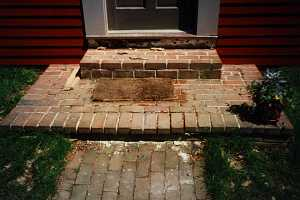 a brick porch and steps - before
