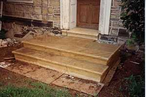 custom stone steps leading to a front door